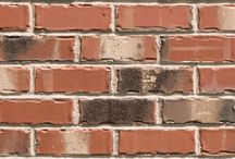 Savannah   Triangle Brick Company / Evocative of the worn cobblestone streets of Historic Savannah, GA, our Savannah brick is a gorgeous historic brick with a smooth red base, and charred black and off-white accents. This tumbled brick is offered as part of Triangle Brick Company's Premium tier, providing our customers with a superior level of product quality and consistency unmatched by our competitors.