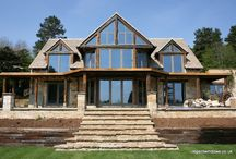 Painswick 2007 / A newbuild from 2007, made using reclaimed stone and oak. Regent installed nine bifolding doors in total. Bifold doors are very popular now, but in 2007 they were quite the novelty!