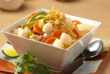 Seafood Soups & Stews / Recipes for seafood packed soups that will warm up any meal!