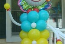 Carnival / Under the Big Top Balloon ideas / Balloon ideas for your Carnival themed or Under the Big Top Event.  Table Centerpieces, columns, arches, backdrops, photo ops and more!