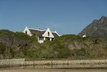 Albertyn Huis / Over a white garden wall and a thick bank of indigenous greenery, Kleinmond beach presents itself as a giant sickle shape of deep blue sea edged with shreds of a white lace wave line. It is a glorious view and must have been the deciding factor for the positioning of the cottage – the first in the area – in the 1860s. http://www.perfecthideaways.co.za/accommodation/albertyn-huis/