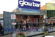 Mobile Bar/Restaurant made from a modified shipping container / Featured here is a mobile bar that was made out of a modified 20' shipping container. The unit consists of custom interior finishes, checker plated flooring, lights and electrical outlets, and a large retractable side wall door/platform. The unit can be fully closed at night keeping all the contents inside safe and secure until the next business day.