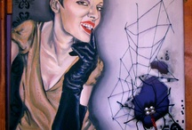 """Paintings: Karmen's portret / Cherchez la Femme Oil on canvas/ mixed media - 40 cm x 60 cm Other details: wired spider, cotton stripes web, lace and black sequins. The canvas is cut in the spider hole area, in order to give the painting a nice 3d effect, and also, for shadow's play (when hanged on the wall). The story: """"The source of any given problem involving a man is liable to be a woman""""."""