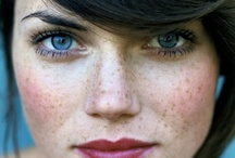 Blue eyes pale skin dark hair
