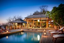 Simbavati Hilltop Lodge / We have 8 luxurious safari tents, offering king-size or twin-bed options. The en-suite bathroom tent is connected to main tent via a small passage, with an opening to the outdoors that gives you an indoor or private twin shower outdoor shower option.