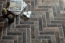 Brick Tiles / Latest natural brick look porcelain tiles. The look of red brick, white brick and more encompassed in a heat, scratch, water and stain resistant porcelain tile.