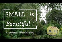 Small is Beautiful / Freedom, simplicity and free rent.   That sounds pretty good, right?  Small is Beautiful is a feature length documentary currently in production. The film is directed by Jeremy Beasley and will be released worldwide in 2014.  http://thetinyhousefilm.com/  The film follows a couple, a young guy and a 50 year old herbalist through their own tiny house journey to see what it's really like to build and live in a tiny house.