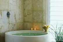 Round stone bath / Shower overhead