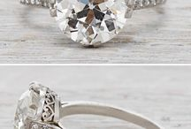 Central diamond with accent shoulders rings
