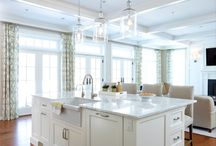 A great design by a great desinger / Thanks to Christine Donner of Christine Donner Kitchen Design of Norwalk, CT, whose photos are shown below. This kitchen shows her minimalistic design.   Chris's design included the Georgetown #10, 4/4 doors with concealed hinges, flush inset cabinet construction, and linen white paint.   A booth and an island large enough to seat 4 adults creates beauty and function.   Chris designed a coffered ceiling with large crown moulding to further define this space.
