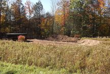 new custom ranch build in Grahamsville, NY / Martell Home Builders of Sparrow Bush, NY has just begun construction of a beautiful 30'x60' custom ranch in Grahamsville, NY. The house is nestled in a small field framed by mature oak trees surrounded by rolling hills. It will feature a raised roof style front covered rocking chair porch as well as cultured stone decorating the front façade giving it an elegant country feel.  The split bedroom floor plan offers excellent usage of all 1800sqft this home has to offer.