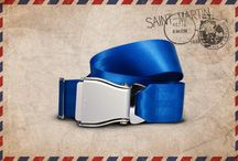 Blue St Martin - Fly-Belts aicraft seat belts redesigned as fashion accessories / Designed by and for international travelers, Fly-Belts are adapted airplane seat belts recast to fit all types of pants and jeans. Express & share your frequent flyer experience with this original travelwear.  - Color : Blue St-Martin - One way pack : 1 buckle + 1 belt - 2 available sizes for buckle thickness and belt's webbing width - Original (48mm) and Slim (38mm) - One length fits all - Airline resistant webbing. Aluminium buckle