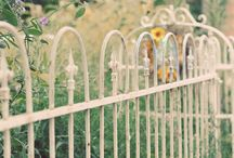 Fences / I've got a good sized yard and am slowly turning it into MY yard, not the one that came with the house.  Someday my house is gonna have a picket fence with lots of flowers along it...but I have to wait on the money tree to grow:-). / by Gayl Lee