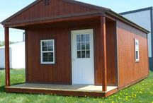 "Cabins / Our Cabins come with many features, including:  *3 - 2x3 Single Pane Windows  *Pressure treated 4"" x 6"" Support Beams  *Pressure treated 5/8"" flooring  *Pressure treated 2"" x 6"" Floor Joists  *Standard wall height 92"" *6'8"" Metal Door with Glass *4' or 6' Porch *Soffit vents *Douglas Fir Siding"