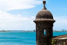 "Travel: Puerto Rico! / Often called the ""Isle of Enchantments"", Puerto Rico won't disappoint! If the white sandy beaches, the turquoise waters, the Bioluminescent bays, or the El Yunque waterfall don't convince you, we don't know what will! Pack your sunscreen and get ready to soak up some rays and lots of culture!"