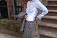 Harlem Boy Style / Yseult Polfliet nails urban androgyny in two classic Thomas Thomas looks: a grey flannel suit with navy piqué waistcoat and Eton collar shirt, and a country check wool suit with a mixed pinstripe shirt.
