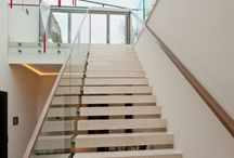 Glass Beam Supported Vertical Glazing / Glass beams can be secured by bonding to a stainless steel shoe or by bolting to a plate.
