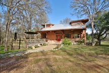 New Listing in Smithville, TX - 122 Fish Camp Road Offered at $289,900 / Beautiful gated 4 bed and 3 bath home in private setting on 2 acres! Home features fantastic solarium, tons of windows providing natural light, vaulted ceilings, wood floors, & mult. living areas. Guest house with full bath. Kitchen boasts panoramic views, breakfast area, stainless steel appliances, & beamed ceilings. Improved basement includes kitchenette. Backyard features mature trees, extended porch & patio, open deck & perfect for entertaining. Creek frontage!