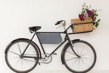 Vintage Bike with Basket for Hire / Our gorgeous vintage bicycle Nancy is a perfect addition to any vintage inspired event, wedding, party or photoshoot. Looks fabulous with seasonal blooms bursting the basket and a personalised message on the board.