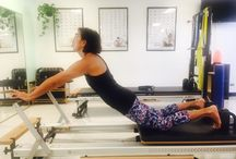 Pilates - Individual Session / Clients demonstrating pilates exercises on the reformer, cadillac, stability chair and ladder barrel