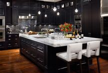 Nias Kitchen / Looking at Black Kitchens with warm wood.