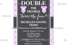 Double Trouble Purple Dots Twins Baby Shower / This design features two baby outfits in purple with a white heart in the center. The background is purple polka dots and a gray chalkboard with a dotted border.