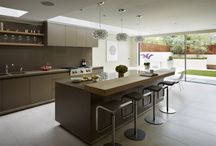 kitchen Architecture bulthaup case study : Modern family living / Kitchen Architecture - bulthaup b3 furniture in clay matt laminate and Silestone work surface in suede finish, with natural oak breakfast bar and shelves.