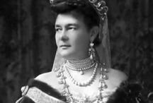 "Tiara - GD Vladimir (UK) / Tiara once owned by the GD Vladimir and hung with pearls. It was bought by Q. Mary in the 1920s, who had it adapted to take the Cambridge emeralds. It's often used by the Queen - hung with the original pearls, or the emeralds, or (occasionally) with neither, that is ""widowed""."