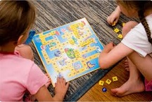 children playing scrabble / kids playing intelligent games