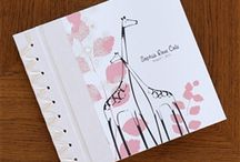 Baby Memory Albums / Baby Memory Books have been our specialty at aimeej keepsakes since 2002.  We offer our own brand as well as baby keepsake albums from Rag & Bone Bindery, Hugs & Kisses, Molly West, Baby Steps, Marcela Creations and other USA-based designers.