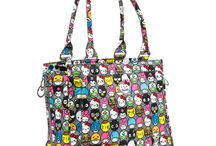 Ju-Ju-Be for Sanrio: Hello Friends / Hello Friends! Say Hello to a print so cute, you'll want to buy a bag for all your friends! The Hello Friends collection by Ju-Ju-Be for Sanrio is a celebration of all things friendship! With its mix of fun Sanrio friends, these whimsical expressions are sure to make you smile. A quick peek inside reveals a pop of vibrant blue lining, a perfect complement to the slate exterior. With its fun, yet neutral tones, you'll want to bring these new friends with you wherever you go!