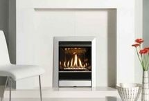 Designer Inset Fires / Our selection of impressive contemporary fireplaces will add a new dimension to your home. Select from wood burning or multi-fuel, gas or electric, our fireplaces will turn your living space into a dramatic focal area.