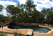Mission Valley san antonio pool project / Custom pool with fire topped Waterfall, multi level decking with bridge and fire pit. Project also has a cabana with fireplace and includes landscaping. Check it out at www.sanantoniopool.net