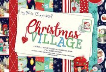 Helz Cuppleditch - Christmas Village / Discover a magical winter wonderland filled with adorable penguins and polar bears with helz cuppleditch's festive collection, Christmas village. This heart-warming collection will help you to capture the joy of Christmas in every make, and includes a selection of papers adorned with traditional snowy scenes. Featuring brightly lit Christmas trees, fairy lights, and pretty repeat patterns, these designs will bring any festive project to life.