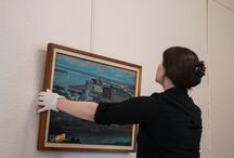 Installation of Petheo Painting on Loan in Duluth Mayor Emily Larson's Office