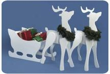 Wooden yard Christmas decorations / by Debbie Bowes