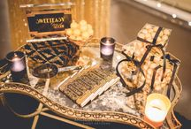 Great Gatsby Wedding / This Great Gatsby style was based on the 2013 movie hit directed by Baz Luhrmann incorporating the bold party atmosphere that Jay Gatsby was renowned for. Setting the scene with an abundant cascading canopy of fairylights and sparkling linen dressed with bold art deco prints, charger plates and our stunning gold cutlery. Wedding reception ideas. Great Gatsby. See the full film on our YouTube channel: https://youtu.be/iYtCL-RsCZY