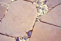 Crafts: Mosaic / Stones near each other making a picture. Bonded and sealed. May or may not be part of a bigger art project.