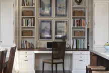 Adjacent to the kitchen and dining areas, an alcove becomes a small home office, with built-in desk and shelves