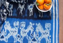 Raya Exchange / Raya Exchange products are hand dyed and hand woven in Central Java, Indonesia.  Their beautiful colors and patterns will add an authentic bohemian touch to your home.