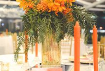 Sophisticated Gold + Tangerine Watercolour Wedding / Crisp white Pintuck tablecloths made for a statement base in this colourful styled wedding. The tall orange taper candles, offset with gold mercury tealights, provided an illuminated statement. The beautiful alternating floral arrangements added that pop of sophisticated freshness emphasizing on the vibrant orange water colour texture used for the wedding stationary. The room was complete with our beautiful fairylight canopy. Youtube: https://www.youtube.com/watch?v=fSlrrOqXU_A&feature=youtu.be