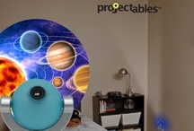 Introducing... Projectables® / Transform your room with Projectables®!  A small round globe uses LEDs to project fun environments and characters on a wall or ceiling.  The Projection Night light is perfect for a child's room.