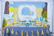 """Elephant Baptism In Rhodes / A Sunday morning in church of traditional Rhode's village,  we designed an elephant theme in yellow, grey and aqua colors! Two big elephants decorated candy table's background that offered cupcakes, biscuits and candies all matched with our theme. Plexiglass coaster with name and an elephant were the favors for adults and a fabric pencilcase for children, all settled up in a theme table with a """"thank you"""" banner and peanut garlands!The baptism set  created by Golden Apple Weddings"""