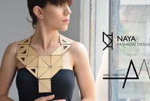 Contemporary Wooden Jewellery, by Anna Moraitou / Jewellery that are not made of precious metals and stones, but of separate wooden pieces tied together with a cord. Each one is made of high quality plywood and covered with transparent protective varnish.
