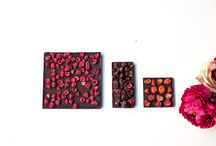 Luxury sweets / Luxury sweets. Board of Emils Gustavs offered chocolate sweets-truffles, perlins, different chocolate bars, cupcakes, macaroons, chocolate figures, cakes, eclairs, berries...