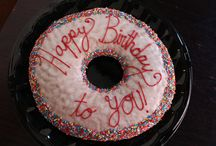 "Jumbo Doughnuts / What's better than a Glazed & Infused doughnut? A JUMBO Glazed & Infused doughnut! Put a smile on someone's  face with a custom message on a giant doughnut. Happy Birthday, Congratulations, Marry Me? It never fails.  The Jumbo doughnut is a raised vanilla ring that's 16"" in diameter. Customize your doughnut with your message  (approximately 30 characters), then choose your glaze, sprinkle color, and icing color. The standard Jumbo  doughnut has vanilla glaze, rainbow sprinkles and red icing."