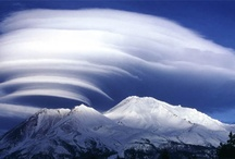 Mt Shasta: Lenticular Clouds  / Lenticular clouds (Altocumulus lenticularis) are stationary lens-shaped clouds that form at high altitudes, normally aligned perpendicular to the wind direction. Lenticular clouds can be separated into altocumulus standing lenticularis (ACSL), stratocumulus standing lenticular (SCSL), and cirrocumulus standing lenticular (CCSL). Due to their shape, they have been offered as an explanation for some Unidentified Flying Object (UFO) sightings.