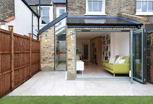Side and rear Kitchen Extension in Balham SW12 / This extension in Balham, Lambeth was designed to offer a distinctive separation between the kitchen and living space whilst remaining open at the same time. The striking custom glazed panel at the rear of the kitchen draws instant attention the moment you enter the room.