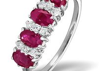 """Ruby Eternity Rings / Ruby is the birthstone for July. It is traditionally gifted on 40th """"Ruby"""" anniversaries, but in modern times has also become popular for 15th wedding anniversaries. Red ruby jewellery is said to remind us of love and passion, making it an extremely popular gift for all romantic occasions."""