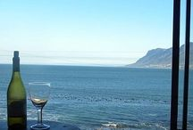 """Kalk Bay House / This spacious sea facing house is definitely for those appreciative of spectacular sunset views to be enjoyed from the comfort of the lounge/entertainment area. There is nothing that says """"relaxation"""" like a beautifully lit sunset sky and a glass of wine or bubbly."""
